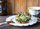 Stuffed portobello mushrooms with herbs and pinenuts