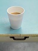 A cup of tea on a light blue cloth