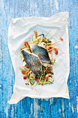 Trout cooked in parchment paper