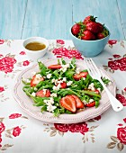 Rocket salad with strawberries and ricotta