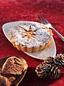 An almond tartlet with icing sugar (Christmas)