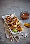 Grilled lady finger banana with a chocolate and caramel sauce