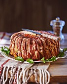 Potato cake wrapped in bacon