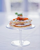 Pancake cake with creamy yogurt, salmon, salmon caviar and dill