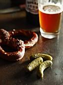 Gherkins, lye bread rolls and beer