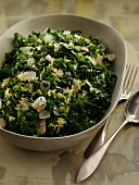 Green kale salad with onions and peas