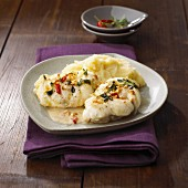 Monk fish medallions with almond sauce and mashed potatoes