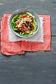Tuna salad with tomatoes, olives and egg served on a lettuce leaf