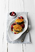 Potato and poppyseed cake with berry sauce