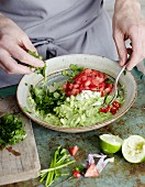 Guacamole being made: ingredients being mixed together