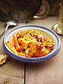 A vegetable tagine with rabbit legs