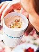 A chai latte with cream and cinnamon sugar