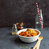 Roasted pumpkin with dates and rice noodles