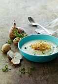 Cream of Jerusalem artichoke soup with Jerusalem artichoke chips and crests