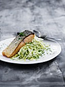 Fried salmon fillet on a bed of white cabbage