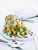 Brussels sprouts salad with Serrano ham, plums and pumpkin seeds