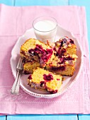 Yeast cake with sour cherries and a glass of milk