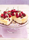 Ricotta cake with cherries and coconut, sliced