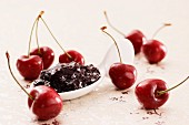 A spoonful of cherry jam and fresh cherries