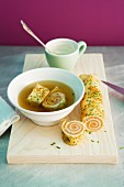 Vegetable stock with salmon pancake rolls