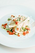Poached fish on a bed of rice with a pepper sauce