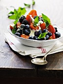 Natural yoghurt with fresh berries and mint