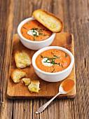 Cream of tomato soup with mascarpone and garlic bread