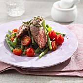 A bean and tomato medley with lamb fillet