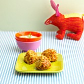Carrot balls with Gouda and yogurt sauce