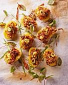 Stuffed potatoes sprinkled with fresh herbs