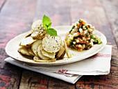 Roasted Jerusalem artichoke slices with a vegetable salad