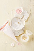 Icing sugar and sugar pearls for decorating cakes