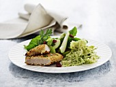 Pork schnitzel with pesto pasta and pear salad