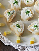 Smoked fish rolls with chive cream