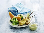 Turkes skewers with broccoli, rice and melon for lunch