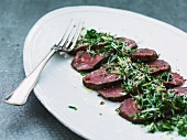 Roast venison with parsley, Parmesan, lemon zest and fennel