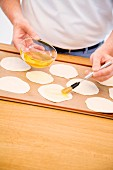 Thin mini unleavened caraway bread being made