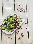 Quinoa salad with vegetables and pomegranate seeds