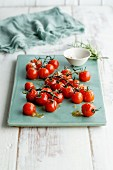 Roasted cocktail tomatoes with rosemary sugar and tonka salt