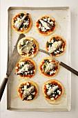 Mini pizzas with sardines
