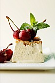 Vanilla ice cream tartlet with cherries and mint