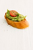 Grilled bread with guacamole and tomato