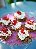 Chocolate crispy cakes with cream and redcurrants