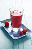 A berry smoothie with fresh strawberries and raspberries