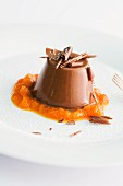 Chocolate and coconut panna cotta on pumpkin compote