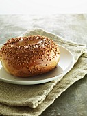 A sesame bagel on plate