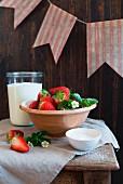 Strawberries, yoghurt and sugar