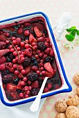A baked berry salad with almond biscuits