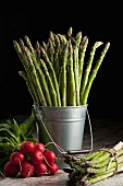 Green asparagus and radishes