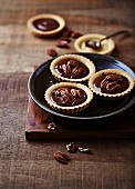 Chocolate tartlets with pecan nuts